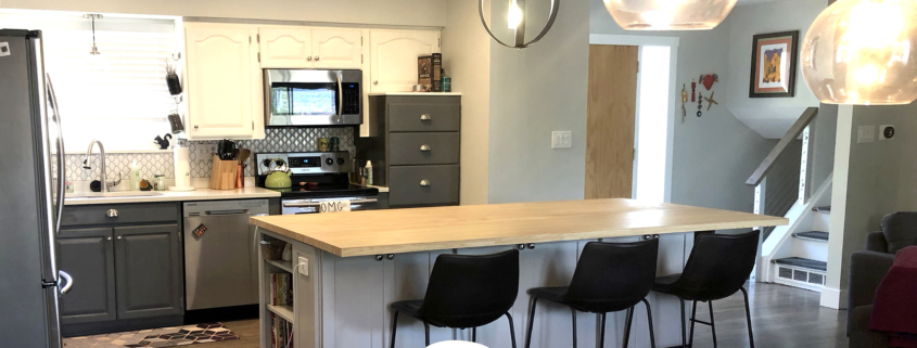 kitchen remodel, butcher block counter, wood top island, accent cabinets, open floor plan, wall removal, slate cabinets, gray island cabinets, light uppser cabinets, mixed cabinets, stainless steel appliances, glass backsplash