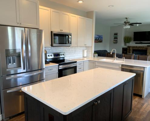 Kitchen remodel, whie cabinets, shaker cabinets, accent cabinets, dark island, quartz counter tops, open kitchen, stainless steel appliances, subway tile backsplash