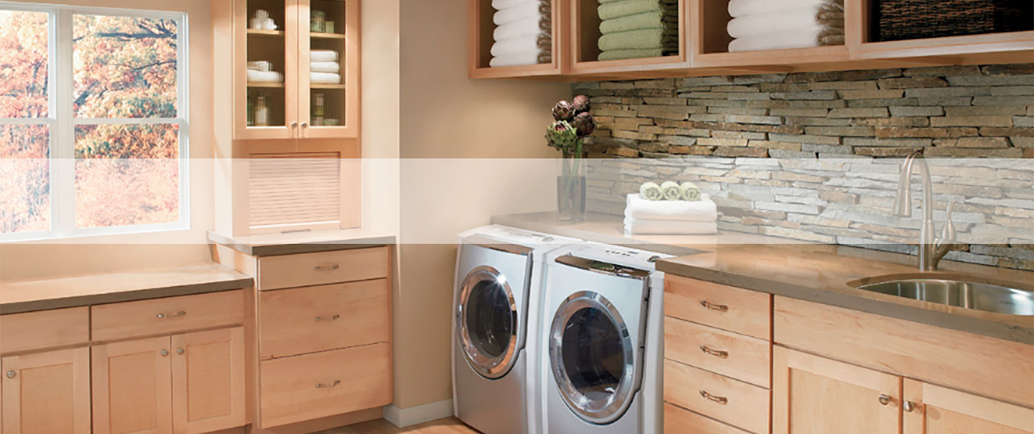 laundry room with built in cabinets and stone backsplash