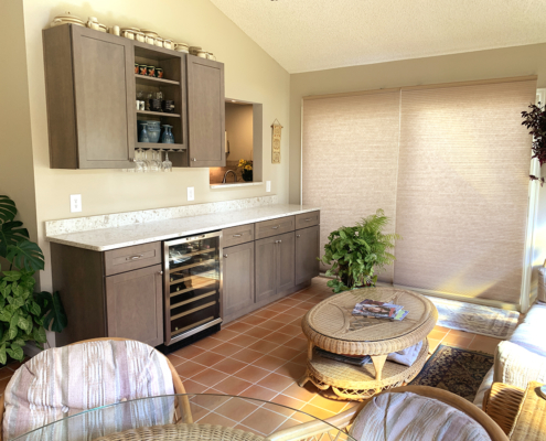 sun room remodel, wet bar, bar remodel, wine fridge, dark wood cabinets, shaker cabinets, wine glass storage, quartz counter tops