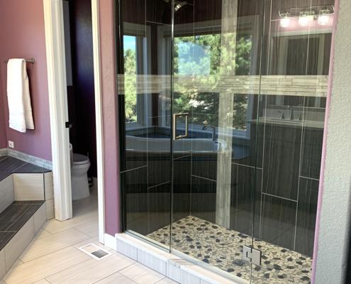 bathroom remodel, gray vanity, custom shower wall tile, glass door shower, frameless glass shower