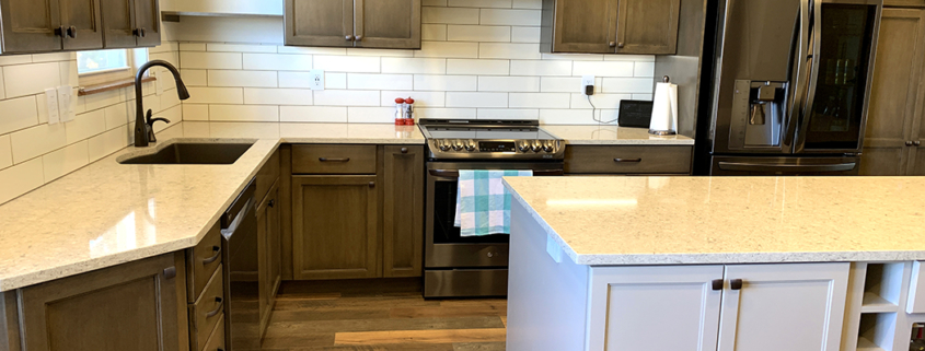 kitchen remodel, shaker cabinets, stainless steel appliances, new island, whie cabinets, built in dining table, under mount sink