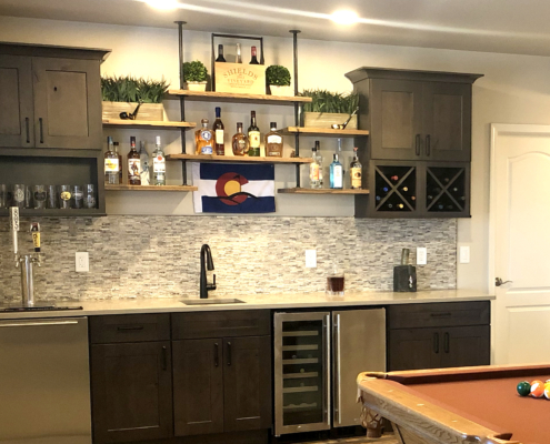wet bar remodel, dry stack stone, stone back splash tile, dark cabinets, shaker cabinets, built in wine rack, stainless steel, wine fridge, dishwasher, custom shelving, rustic shelves, pipe shelves, under mount sink