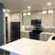 kitchen remodel colorado springs, white cabinets, stainless steel apppliances, under mount sink, multi color backsplash, glass backsplash, stacked cabinets, in cabinet lighting, can lights glass front cabinets, quartz counter tops