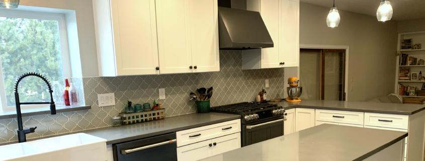 kitchen remodel, white cabinets, dark hardware, black stainless steel appliances, quartz counter tops, glass tile backsplash