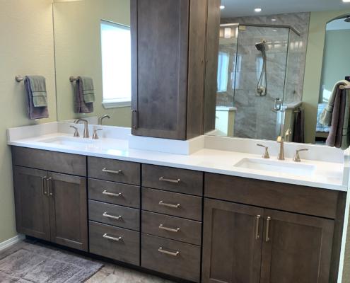 Bathroom remodel, shaker cabinets, dark wood cabinets, split mirror, glass wall shower, quartz couner top, vanity tower, 4 light bar