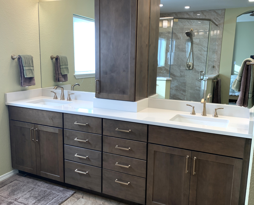 Bathroom remodel, shaker cabinets, dark wood cabinets, split mirror, glass wall shower, quartz couner top, vanity tower, 4 light bar