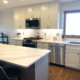 White cabinets, Stainless Steel Appliances, Breakfast Bar, Subway Tile Backsplash, Quartz Counter